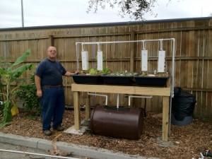 David Hart next to Backyard Hybrid System with Sahib Sandwich Towers hung